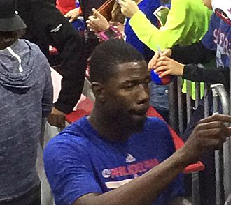 Henry Sims - Sims signing an autograph on December 19, 2014