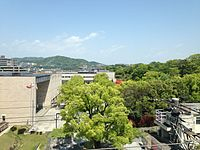 Hiroshima Prefectural Museum of History and Fukuyama Museum of Art from platform of Fukuyama Station (Sanyo Shinkansen).JPG