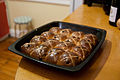 Hot Cross Buns in black bakeware on counter.jpg