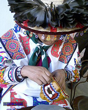 Jalisco - A Huichol man making a beaded jaguar head