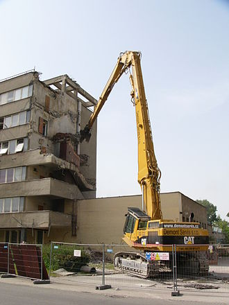Demolition - A high-reach excavator is used to demolish this tower block.