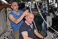 ISS-48 Jeff Williams gets a haircut from Anatoli Ivanishin inside the Destiny lab.jpg