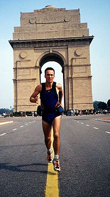 Full-length photo of Robert Garside beginning his world-record around-the-world run from the monument of India Gate, New Delhi, India.