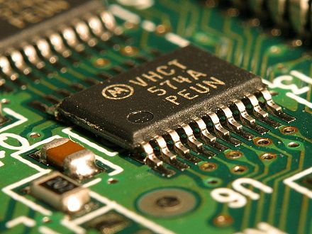 An integrated circuit (IC) on a printed circuit board. This is called a solid state circuit because all of the electrical action in the circuit occurs within solid materials. Integrated circuit on microchip.jpg