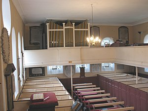 St Peter's Church, Petersham - The interior of the church, showing the Georgian box pews and the unusual gallery organ