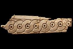 Plaque fragment: braid