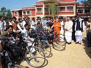 Rambhadracharya - Rambhadracharya with mobility-impaired students in front of the main building of Jagadguru Rambhadracharya Handicapped University on 2 January 2005