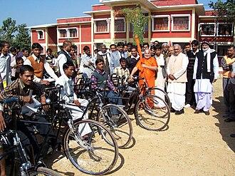 Rambhadracharya - Rambhadracharya with mobility-impaired students in front of the main building of Jagadguru Rambhadracharya Handicapped University on 2 January 2005