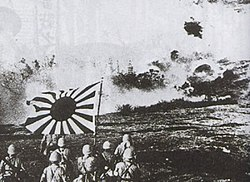 Japanese naval landing forces blasting Chinese pillbox and marching with the naval flag, Canton Operation