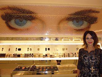 Jodi Shelton - Shelton poses next to Norbert Brunner's artwork her eyes inspired.