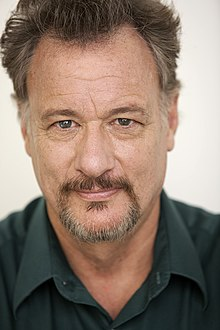 de Lancie looking to the camera