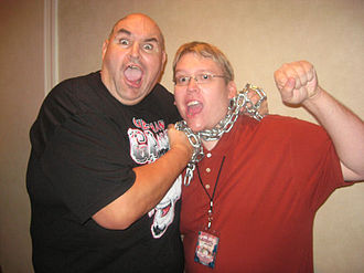 One Man Gang - One Man Gang posing with a fan in October 2008 while holding his signature chain.