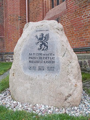 Szczecin - The stone near Szczecin Cathedral commemorating Kashubians with an image of the Pomeranian Griffin