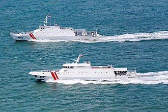 Indonesian Maritime Security Agency - Two BAKAMLA patrol boats during a patrol.