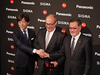 Leica L-Mount - Kazuto Yamaki (Sigma), Andreas Kaufmann (Leica Camera) and Junichiro Kitagawa (Panasonic) after the announcement of the L-Mount Alliance on 25 September 2018 at photokina in Cologne