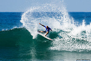 Kelly Slater surfing in the Boost Mobile Pro e...