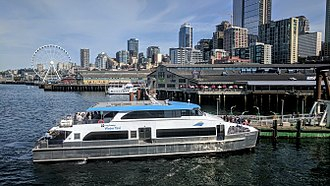 King County Water Taxi - The MV Doc Maynard at the new (as of August 2017) temporary King County Water Taxi terminal at Pier 52, on the north side of the Seattle Ferry Terminal.  This boat serves the West Seattle–Seattle route.