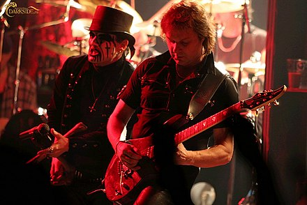 King Diamond, known for writing conceptual lyrics about horror stories. King Diamond live 2006 Moscow 02.jpg