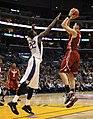 Klay Thompson shoots over Justin Holiday.jpg