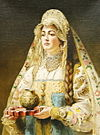 Konstantin Makovsky - woman in a Russian dress.jpg