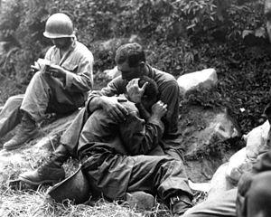 Korean War - G.I. comforting a grieving infantryman