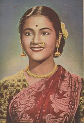 Young smiling Indian woman wearing a sari.