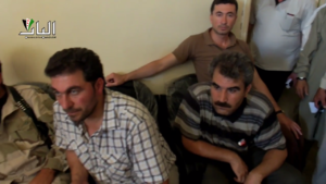 "Jabhat al-Akrad - Muhammad Mustafa ""Abu Adel"" (left) and Shervan Derwish (right), two commanders of the Kurdish Front, in Qabasin during the signing of an agreement with other rebel groups in July 2013"
