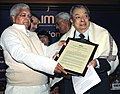 Lalu Prasad presenting the Life Time Achievement Award for Management to Dr. V. Kumrien, Founder Chairman, National Dairy Development Board, Anand, at the Foundation Day of All India Management Association (AIMA).jpg