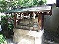 Le Temple Shintô Kan-daijin-jinja - La statue de pierre d'une vache couchée2.jpg