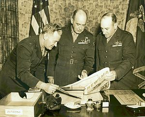 Leo D. Hermle - Leo D. Hermle, Alexander Vandegrift, and Julian C. Smith look at a Newsmap while the 2nd Marine Division was stationed in New Zealand during World War II.