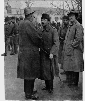 1913 Ottoman coup d'état - Enver Bey (center) speaking to a correspondent for the French magazine L'Illustration and the British attaché in Istanbul immediately after seizing power in the coup.