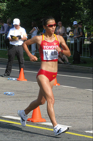 "Racewalking - Liu Hong ""flying"" (out of contact with the ground) in sight of the judges during Women's 20 kilometres walk at the 2013 World Championships in Athletics where she won bronze"