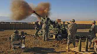 Artillery - 7-person gun crew firing a US M777 Light Towed Howitzer, War in Afghanistan, 2009.