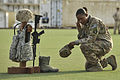 MPOTY 2014 U.S. Air Force Master Sgt. kneels in front of a battlefield cross.jpg