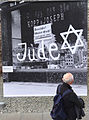 Man Views Photo of Nazi-Boycotted Jewish Shop - Topography of Terror Outdoor Exhibit - Berlin - Germany.jpg