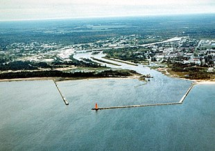 """Aerial view of Manistique. The <a href=""""http://search.lycos.com/web/?_z=0&q=%22Manistique%20River%22"""">Manistique River</a> flows into Lake Michigan through the center of the city"""