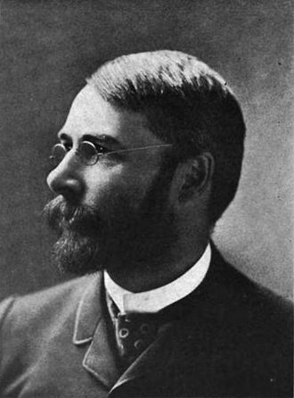 Marcus Baker - Photograph of Marcus Baker as a young man in wire-rim glasses with a dark beard. Probably from the early 1880s when Baker worked in Los Angeles.