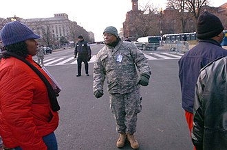 158th Cavalry Regiment (United States) - A Guardsman from the 158th Cavalry assists at the First inauguration of Barack Obama, 20 January 2009