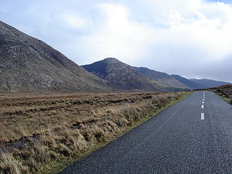 """Maumturks - Maumturk Mountains, looking southeastwards from the Inagh Valley with Knocknahillion's distinctive """"diagonal stripes"""" featuring in the centre."""