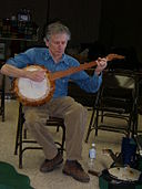 Mike Seeger plays gourd banjo at Breakin Up Winter.JPG