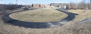 Mineral Water Bowl - Roosevelt Field at Excelsior Springs High School which was home to the bowl until the school moved in 2003.  The stadium is on the banks of the Fishing River near downtown Excelsior Springs blocks from the Hall of Waters Historic District and Elms Hotel
