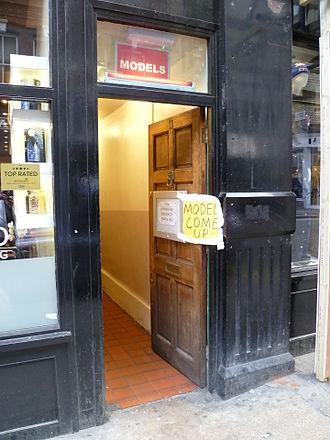 "Soho walk-up - A doorway advertising ""Models"" in Brewer Street, Soho, London. An example of a Soho walk-up."