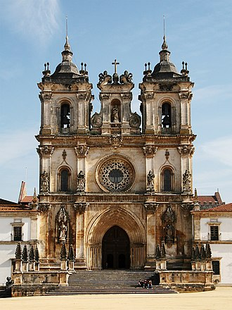Alcobaça Monastery - Façade of the Monastery of Alcobaça. The portal and rose window of the church are original gothic (early 13th century), while the towers are baroque (18th century).