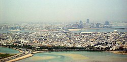 View of  Muharraq with the skyline of Manama in the background