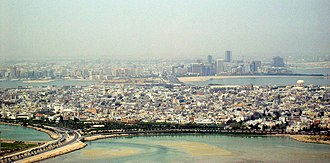 The cities of Muharraq (foreground) and Manama (background) Muharraq and Manama.jpg