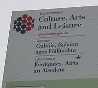 A sign for the Department of Culture, Leisure, and Arts in Northern Ireland, in English, Irish, and Ulster Scots.