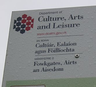 Culture of Northern Ireland - The brand identity of the Department of Culture, Arts and Leisure in Northern Ireland as shown on this sign is displayed in English, Irish and Ulster Scots