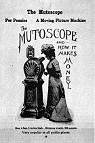 "An 1899 advertisement for the mutoscope reading ""The Mutoscope and how it makes money"" in large stylised letters with ""for pennies, a moving picture machine, popular in all public places"" in smaller lettering around a central picture. In the image, a lady wearing a long early 20th century dress and hat peers down the mutoscope viewfinder."