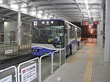 Bus with a driver on a guideway