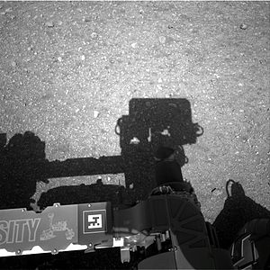 Curiosity (rover) - Masthead casts a shadow in this NavCam image on Sol 2 (August 8, 2012)
